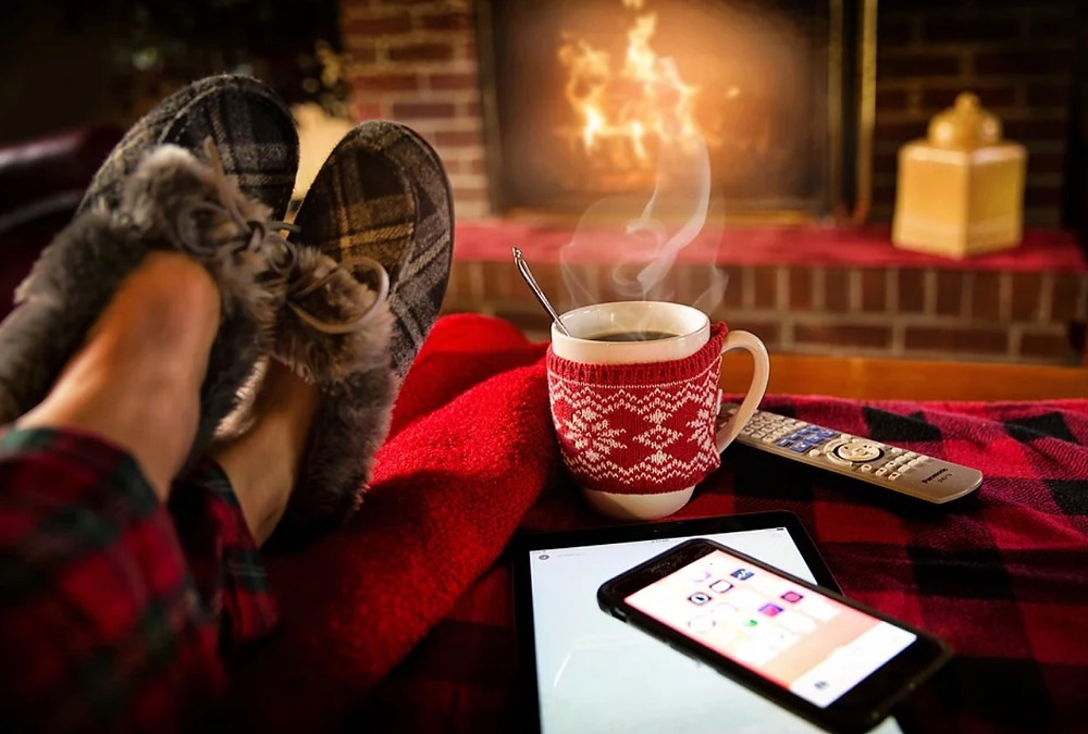 cozy winter picture coffee by the fireplace with plaid slippers