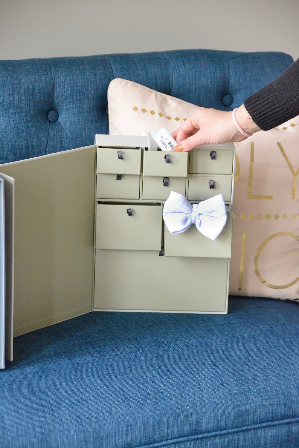 savor-keepsake-memory-box-with-hospital-bracelet-and-newborn-hat-on-our-life-in-rose-gold-blog