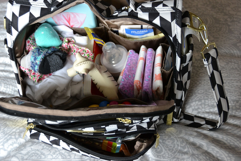 how-to-stock-your-diaper-bag-what-you-need-on-the-go-new-moms-born-to-be-a-bride