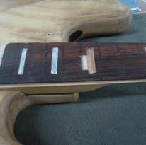 Severe damage to the fretboard - unfortunately so severe that it will need to be replaced.
