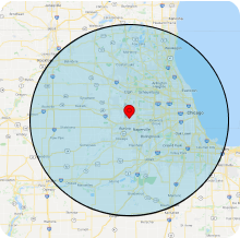 a red marker showing the location of Aurora, Illinois with a green circle showing the extension of 50 miles in all directions showcasing the areas OXE Cleaners services