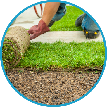 a person is laying down sod or grass covering