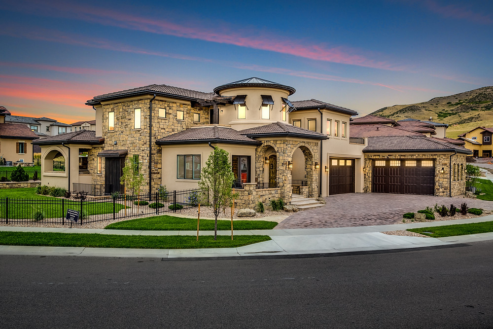 Situated on a Corner Lot in Solterra this house was designed as a Modern Tuscan Home.  The garage is oversized and can hold up to 6 cars.  One challenge was the large Garage Doors measuring 18x10.  Everything had to stay in proportion and the Entry had to remain the predominate feature.