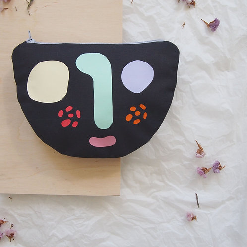 ABSTRACT FACE pouch
