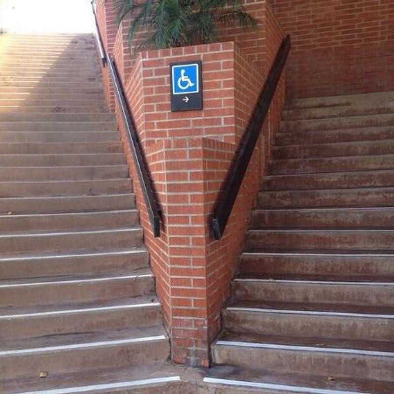 """""""Damn it. Everytime I come here I gotta carry this stupid wheelchair up the stairs..."""""""