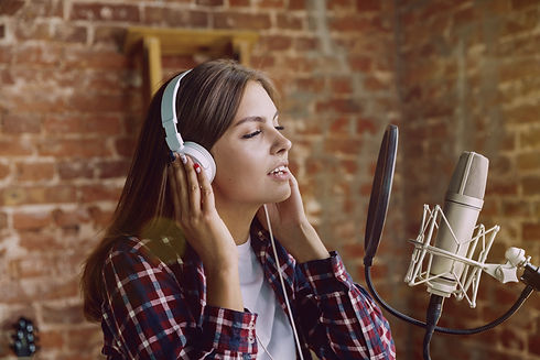 stock-photo-woman-in-headphones-recordin