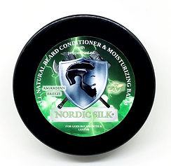 "NuBorn Skin's product Nordic Silk® - an all-natural beard conditioner & moisturizer. A hemp-based balm with a soft vanilla-almond aura ""touched with a hint of lime"" scent that deeply conditions and promotes healthy, stellar growth for ALL beard types. While treating your beard, it simultaneously moisturizes your skin while greatly reducing itchiness without the oily residue. Nordic Silk is specifically designed to foster thick and lush growth with an accentuating godlike sheen. It can also be comfortably used in either dry, or African American/ethnic hair in addition to being used solely as a daily moisturizer."