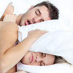 Scenic in bedroom of young couple lying