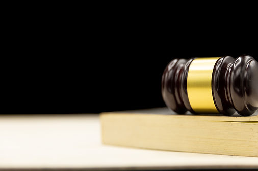 judges-gavel-on-book-and-wooden-table-law-and-justice-concept-background.jpg