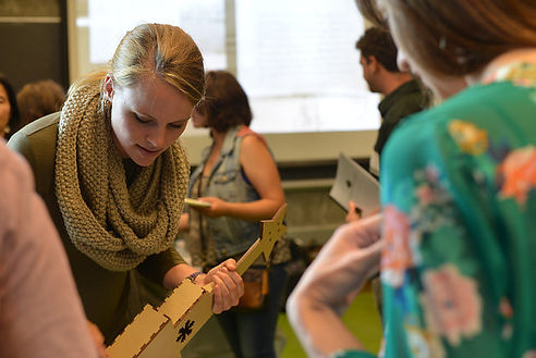 Christine Dierk demonstrates Ukulele Fabrication software and shows off fabricated ukulele at the BCNM Fall Open House