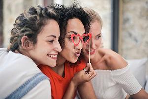 three-women-posing-for-photo-1524105.jpg