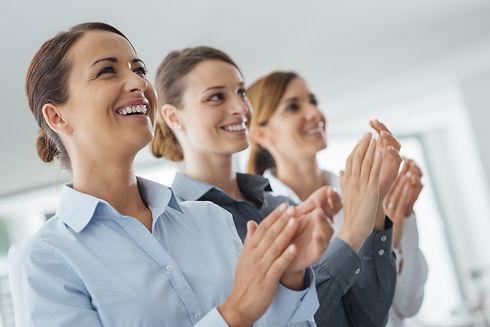 Cheerful confident business women applau