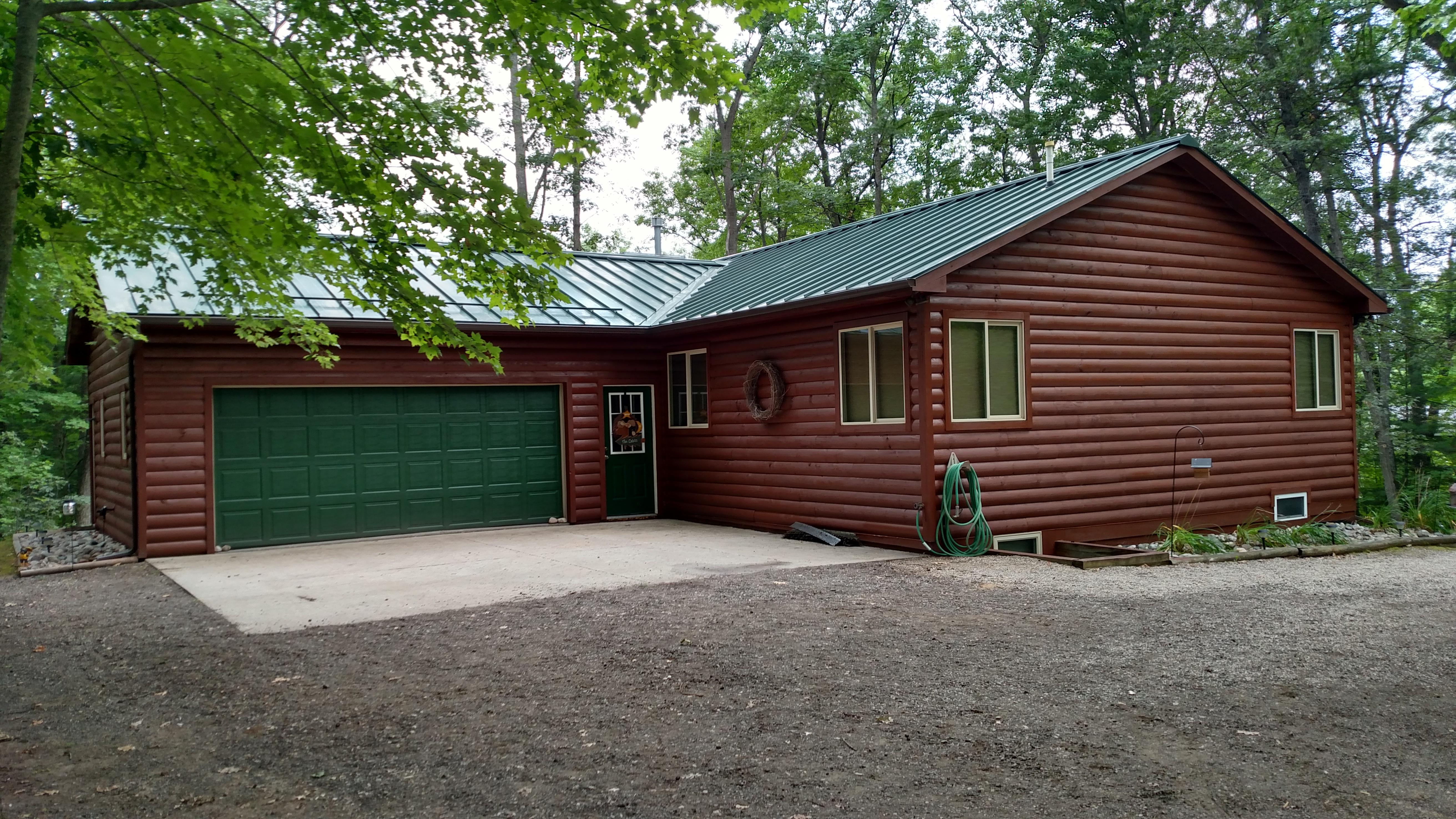 Husky Metal Roofs - Standing Seam Green Cabin