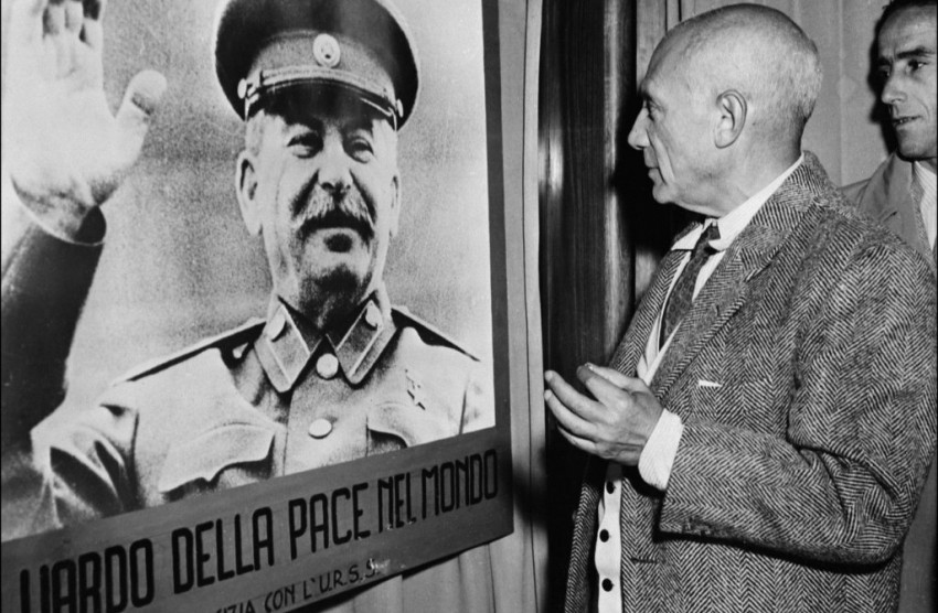Picaso peering a portrait of Stalin