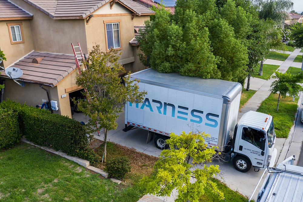 Harness work truck at customer's home during solar install