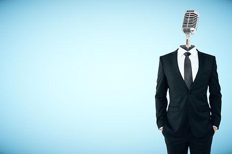 Microphone headed businessman on blue ba