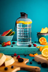 slices-assorted-fruits-near-water-bottle