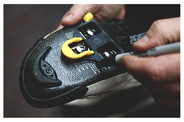 Cleat position is optimised in ll bikefit services offerred a garry kirk bike fitting. Here cleat orientation is being marked on a BONT race shoe.