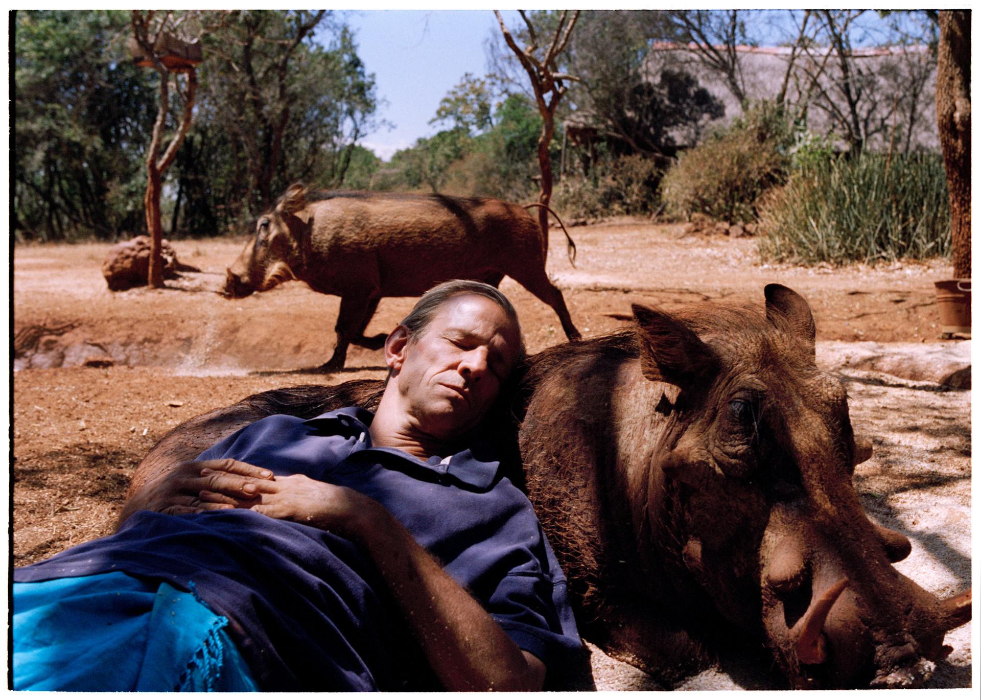 Peter Beard resting on hog