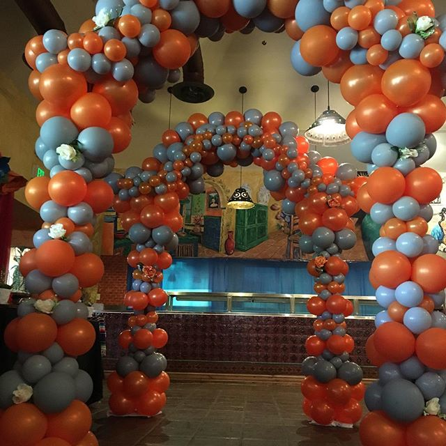 Organic balloon arch with floral designs