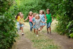kids-children-running-on-green-meadow