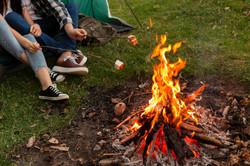 close-up-young-couple-enjoying-bonfire