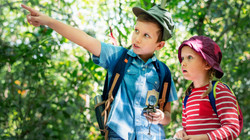 two-cute-kids-trekking-in-the-forest