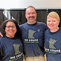 """Two women and one man smiling in """"We Count"""" census shirts"""