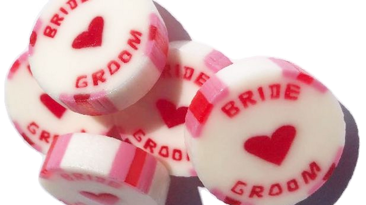 Red and Pink Bride and Groom wedding favour rock sweets