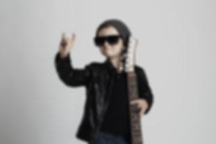 Funny rock child with guitar. fashionabl
