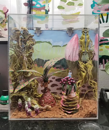 An alien swamp terrarium for one of Sara's pet praying mantises. Epoxy clay on recyclables, paper mache, 2018.