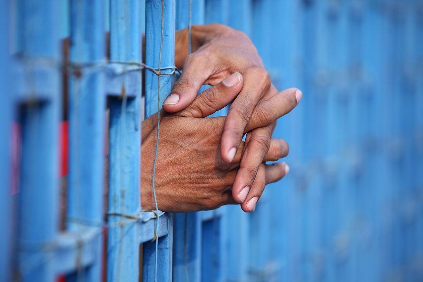 Canva - prisoner in jail.jpg