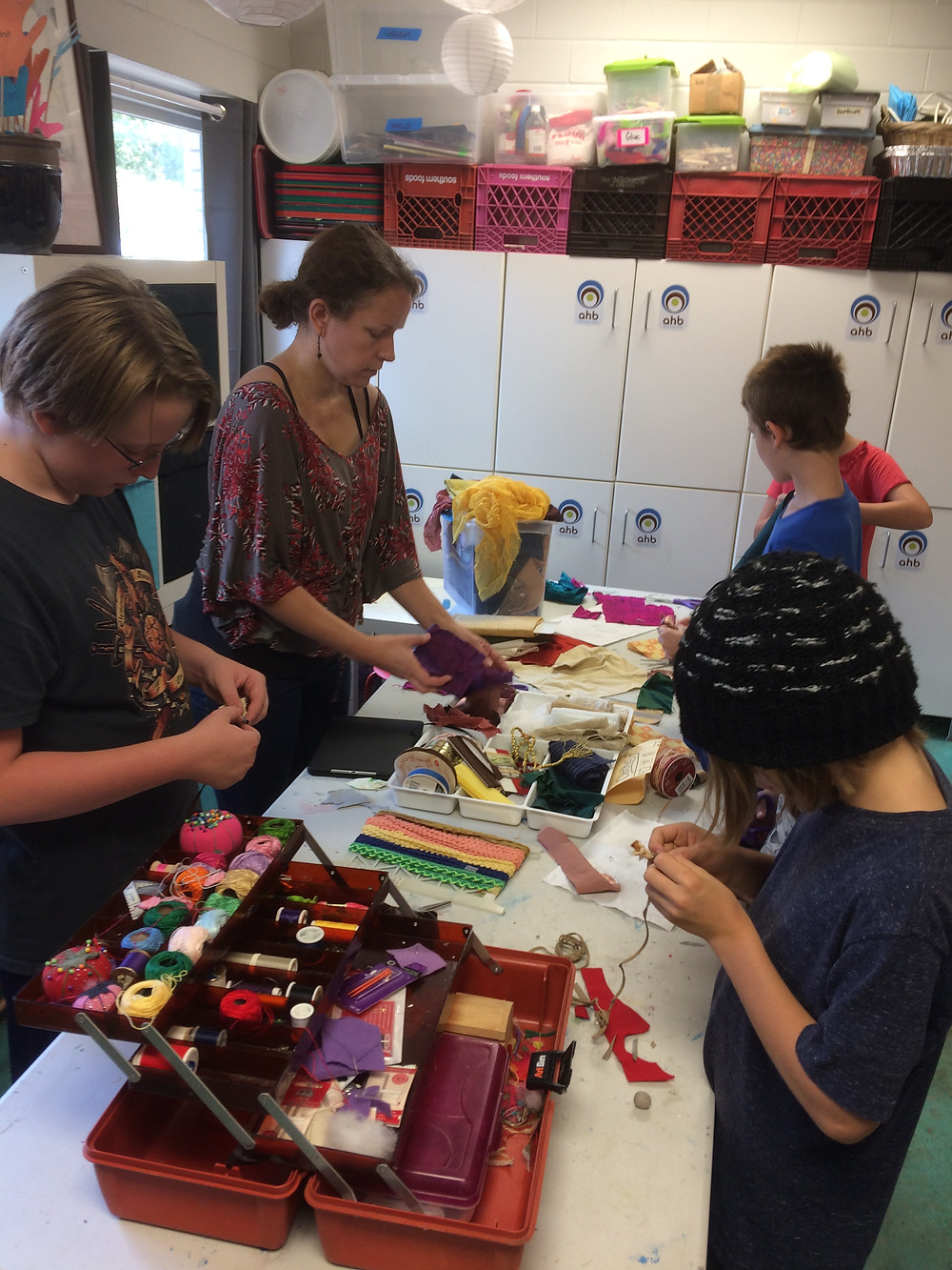 The Village sewing station in full swing as Villagers craft the Peeps first outfits.