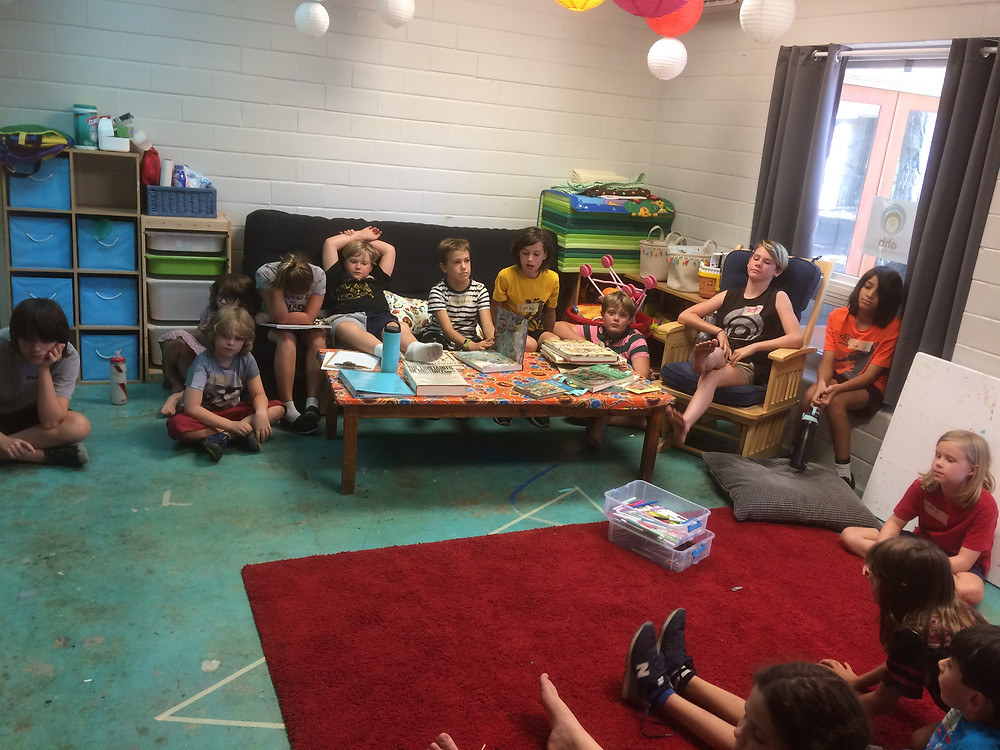 Villagers gathered together to share what they know and wonder about life in the Middle Ages.