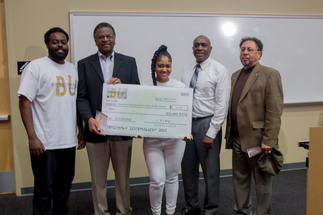 Organizer presenting The Boss Up! Scholarship