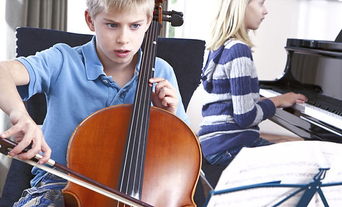 Boy%2520and%2520girl%2520playing%2520cello%2520and%2520piano%2520at%2520home_edited_edited.jpg