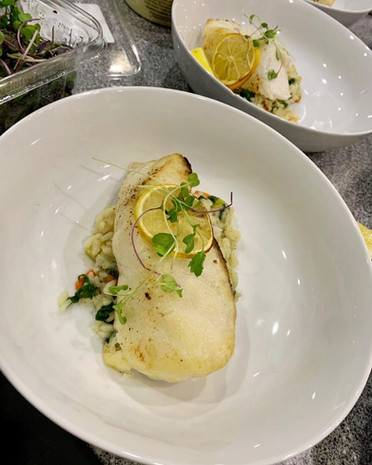 Roasted Sea Bass atop Herbed Pearl Couscous