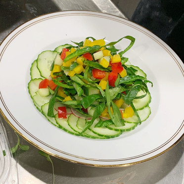 Tossed Julienne Spinach Salad with Peppers and Cucumbers..