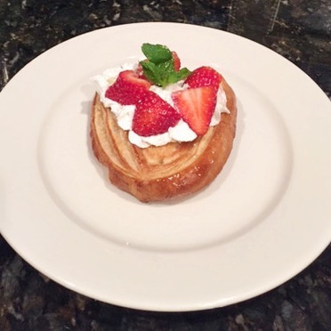 Palmier topped with Whipped Cream and Strawberries.