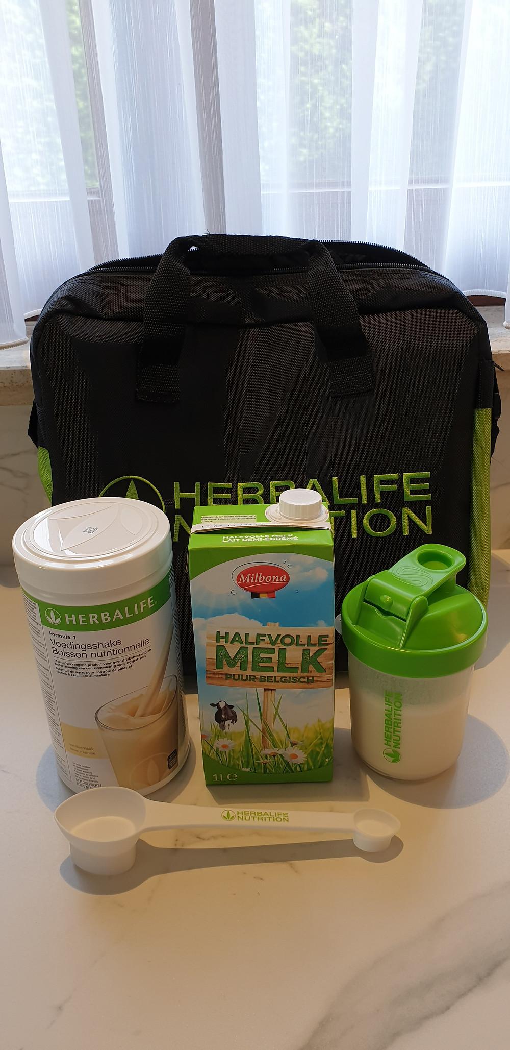 Formula 1 Nutritional shake + 300 ml. Cow milk + Shaker + Measuring spoon.