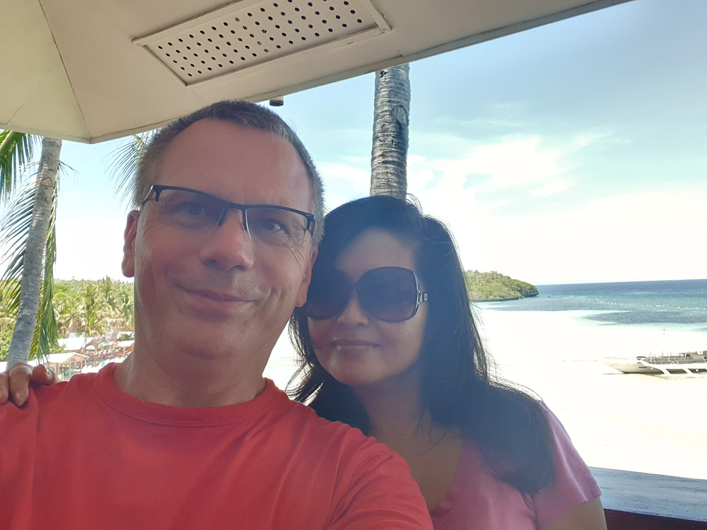 My wife Eva and I on the beautiful island of Camotes with white beaches and clear blue sea water.