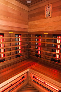 the interior of a small wooden infrarered sauna booth in a spa.jpg