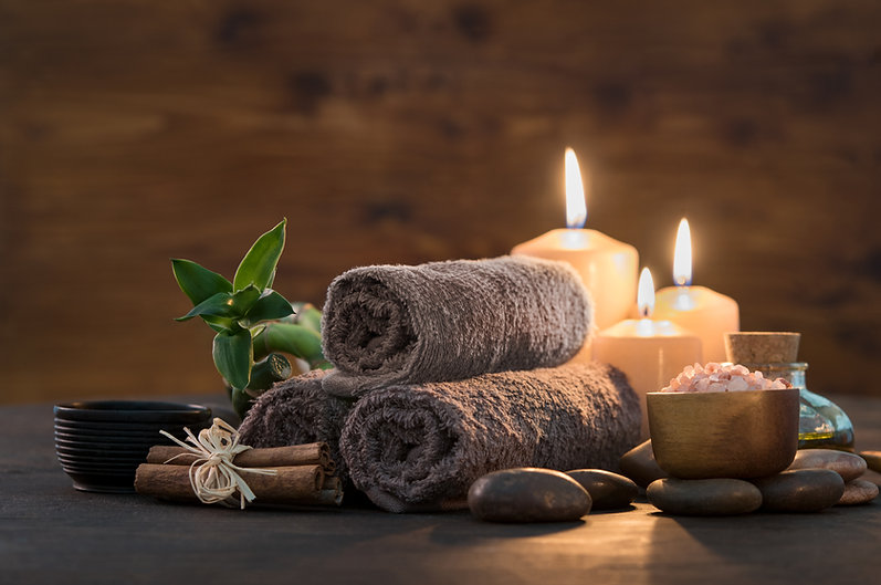 Brown towels with bamboo and candles for
