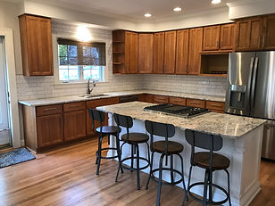 New floor, island, counters and backsplash