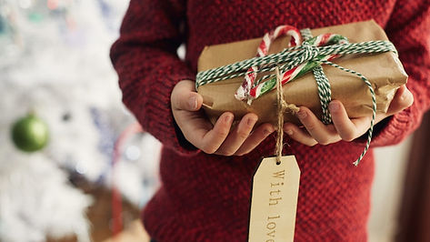 person-holding-christmas-gift.jpg