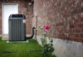 air-conditioner-on-backyard-31978166.jpg