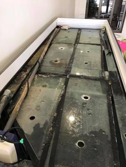 Scrubing of tank glass covers