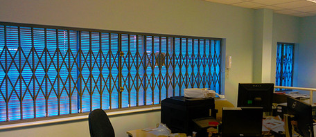 Retracable grilles to office space