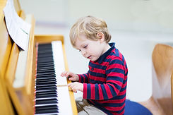 Two Years Old Toddler Boy Playing Piano,