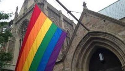 lgbt flag at church building
